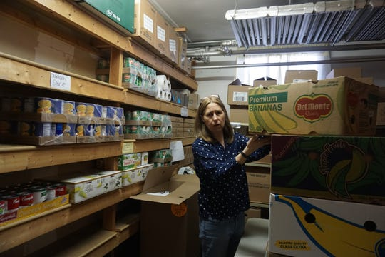Joyce Donohue, a Sloatsburg resident and parent, at the Sloatsburg Food Pantry where she volunteers on March 26, 2019. Donohue is in the storage area of the food pantry, where they keep some of the donated food.