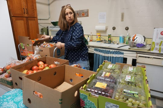 Joyce Donohue, a Sloatsburg resident and parent who started a snack donating program with the Sloatsburg Food Pantry and some Suffern Central School district elementary schools, packing fresh produce at the pantry on March 26, 2019. Donohue wanted to help students who's parents were having difficulties getting their child food for snack time. Now the snack program is in three elementary schools, including Sloatsburg Elementary, R.P Connor Elementary and Viola Elementary.