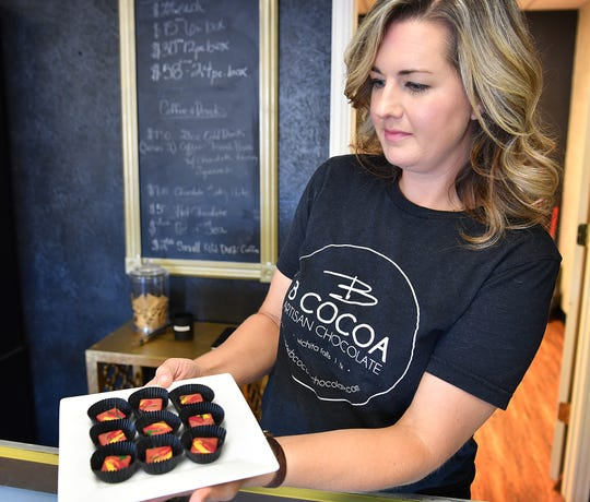 Brooke Willis, owner of B Cocoa Artisan Chocolate, displays her Strawberry Lemon bon bons at her current location in Finishing Touch Plaza. Willis is moving her business downtown to the Oil & Gas Building in August.