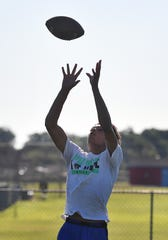 Isaiah Wilson goes up for a catch during practice as the Hirschi Huskies prepare for a 7 on 7 state football tournament later this week.