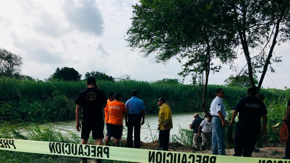 Authorities stand behind yellow warning tape along the Rio Grande bank where the bodies of Salvadoran migrant Oscar Alberto Martínez Ramírez and his nearly 2-year-old daughter Valeria were found, in Matamoros, Mexico, Monday, June 24, 2019, after they drowned trying to cross the river to Brownsville, Texas. Martinez' wife, Tania told Mexican authorities she watched her husband and child disappear in the strong current. (AP Photo/Julia Le Duc) ORG XMIT: MEX105