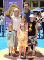 "Tori Spelling, Dean McDermott and children Finn McDermott, Liam McDermott, Stella McDermott and Hattie McDermott attend the premiere of ""The Emoji Movie"" on July 23, 2017 in Westwood, California."