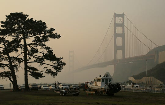 The Golden Gate Bridge is obscured by smoke and haze from wildfires in this view from Fort Baker near Sausalito, Calif.