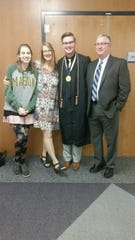 Christian Barnard and his family, sister Melody, mother Cathleen and father Butch, at Messiah College's graduation in Mechanicsburg, Pennsylvania, in May 2017.