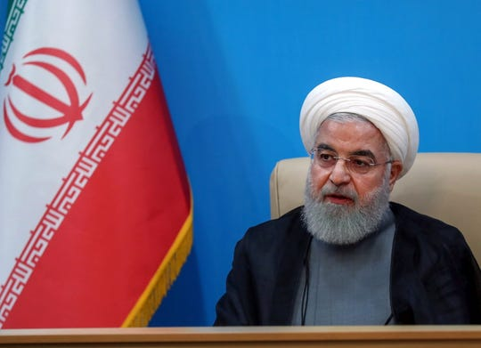 A handout photo made available by presidential office shows Iranian President Hassan Rouhani during a meeting with health ministry officials in Tehran, Iran on Tuesday. Media reported that Rouhani called US sanctions against Iran and its leadership 'idiotic' and 'outrageous' after US President Trump said he was imposing hard-hitting new sanctions on the country.