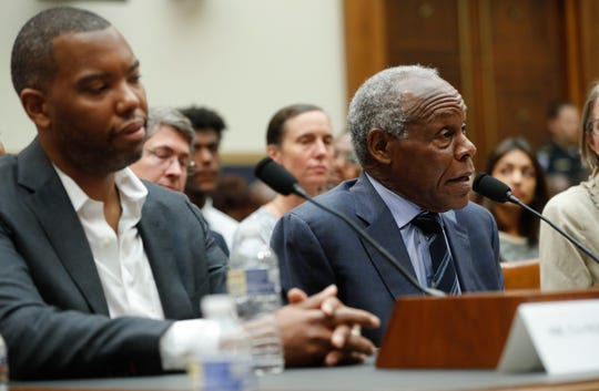 Actor Danny Glover, right, and author Ta-Nehisi Coates, left, testify about reparation for the descendants of slaves during a hearing before the House Judiciary Subcommittee on the Constitution, Civil Rights and Civil Liberties, at the Capitol in Washington, Wednesday, June 19, 2019.