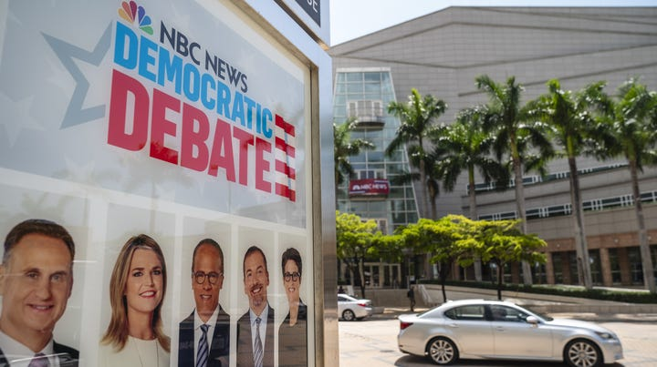 MIAMI, FL - JUNE 25: An advertisement touts the first Democratic presidential primary debates for the 2020 elections outside the Adrienne Arsht Center for the Performing Arts June 25, 2019 in Miami, Florida. Twenty candidates will participate in two groups June 26 and 27. NBC News, MSNBC and Telemundo are hosting the debates. (Photo by Drew Angerer/Getty Images) ORG XMIT: 775360291 ORIG FILE ID: 1151857963