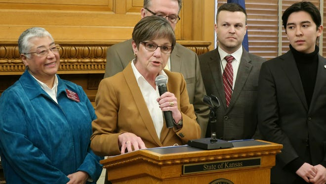 In this Tuesday, Jan. 15, 2019, file photo, Kansas Gov. Laura Kelly answers questions about her executive order to ban anti-LGBTQ discrimination in state hiring and employment decisions during a news conference at the Statehouse in Topeka, Kansas. Kelly's administration will allow transgender people to change their birth certificates as part of a settlement to end a federal lawsuit.