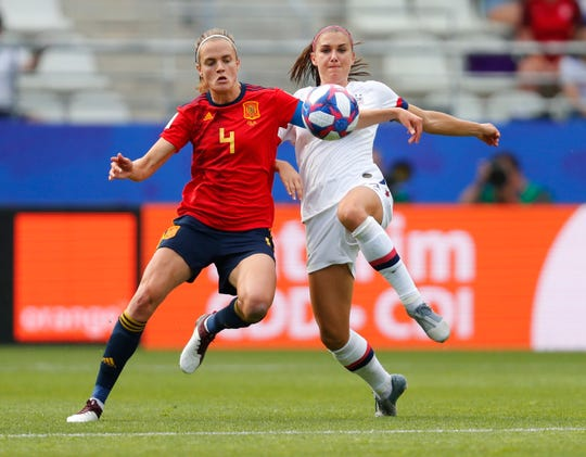 U.S. forward Alex Morgan, right, battles for the ball with Spain defender Irene Paredes during the first half in a round of 16 match in the FIFA Women's World Cup France 2019 at Stade Auguste-Delaune in Reims, France.