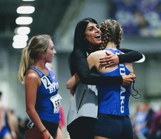 BYU's Emma Gee, left, stands by as coach Diljeet Taylor congratulates a teammate.