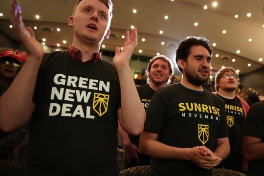 "Supporters of the ""Green New Deal"" participate in a rally at Howard University May 13, 2019 in Washington, DC."
