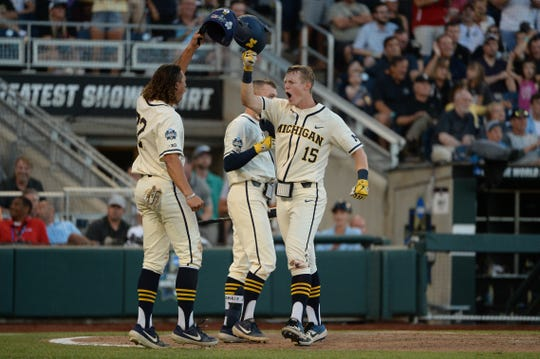 Michigan Wolverines first baseman Jimmy Kerr celebrates after hitting a two-run home run during the seventh inning.