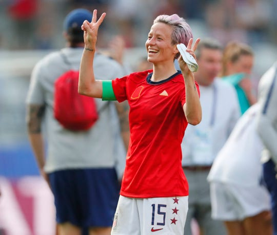 United States forward Megan Rapinoe (15) celebrates after defeating Spain in the Round of 16 match at the World Cup.