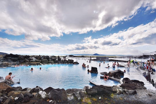 The naturally heated Mývatn Nature Baths has fine views over North Iceland's volcanic countryside.