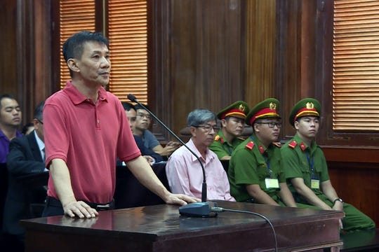 This picture from the Vietnam News Agency taken and released on June 24, 2019 shows US citizen Michael Nguyen standing on trial in Ho Chi Minh City.