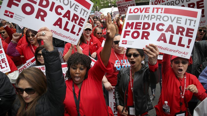 Protesters supporting Medicare for All hold a rally outside PhRMA headquarters April 29, 2019 in Washington, DC. The rally was held by the group Progressive Democrats of America.