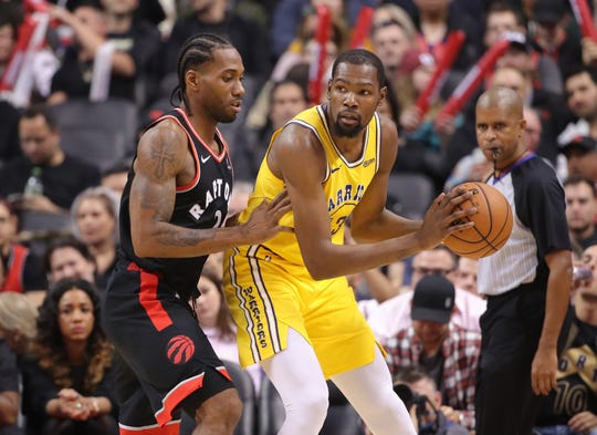 Toronto Raptors forward Kawhi Leonard guards Golden State Warriors forward Kevin Durant.