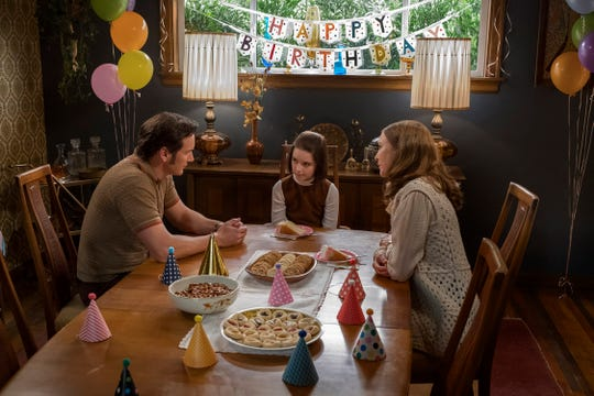 "Ed and Lorraine Warren (Patrick Wilson and Vera Farmiga) celebrate a lonely birthday with their daughter, Judy (Mckenna Grace), in ""Annabelle Comes Home."""