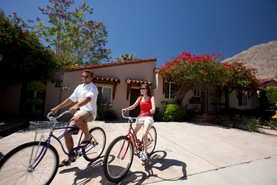A couple bikes through Palm Springs, a popular activity for seeing the sites and scenes of the city.