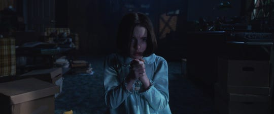 """Judy Warren (Mckenna Grace) uses the power of prayer in """"Annabelle Comes Home."""""""