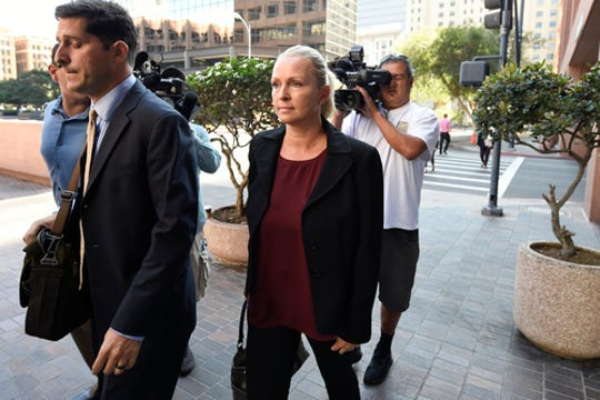 U.S. Rep. Duncan Hunter, R-Alpine, and his wife, Margaret Hunter, arrive for an arraignment hearing at federal court on June 12, 2019 in San Diego, Calif.