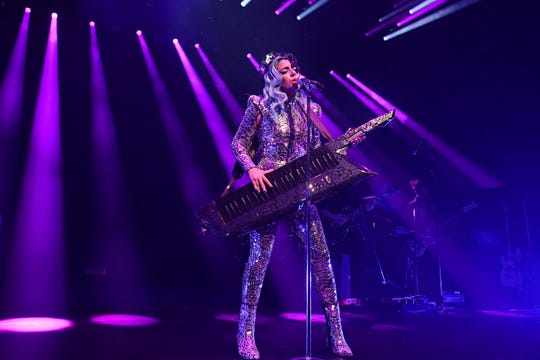 """Lady Gaga opened the show in a glittery silver jumpsuit and headpiece, singing her breakthrough single """"Just Dance."""""""