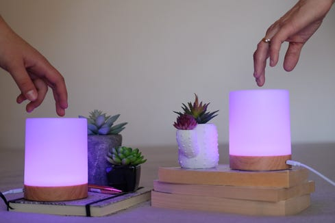 Friendship Lamps light up when one person touches them.