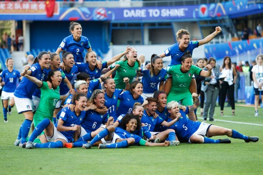 Italian players celebrate after beating China 2-0 in the round of 16.