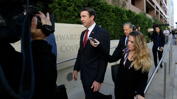 FILE - In this Dec. 3, 2018 file photo Republican Rep. Duncan Hunter, center, leaves court in San Diego. (AP Photo/Gregory Bull, File) ORG XMIT: LA701