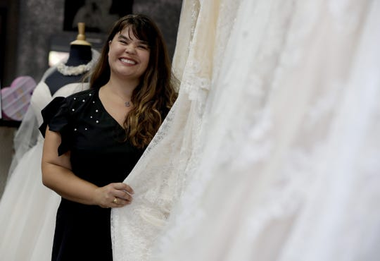Ann Campeau, owner of Strut Bridal, stands in her shop in Tempe, Ariz. Cut-rate prices on websites that sell wedding dresses direct from China put pressure on Campeau, who owns four bridal shops in California and Arizona. She has had customers come in after seeing low-end gowns online and expecting to get a dress at a similar price.