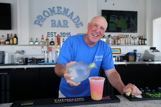 Mike Flynn of West Long Branch, bartender, mixes a drink at the Promenade Beach Club, a full-service, family-owned beach club that is celebrating its 20th anniversary this year, in Long Branch, NJ Wednesday June 26, 2019.