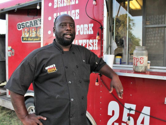 Oscar Weeks II talks about his plans by his bright red trailer that recently has been parked west of Rose Park in Abilene. He learned his trade from his father, who for years treated Cisco residents to barbecue.