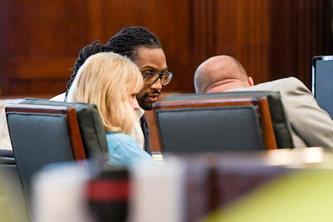 Nathaniel Dixon talks with his attorneys after being found guilty of first-degree murder, attempted first-degree murder and malicious maiming June 26, 2019.