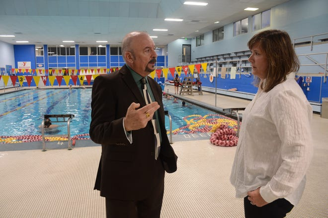 Board Treasurer Donnie Speck and YMCA CEO Jill Hind in the pool area where new energy savings lights have been installed.