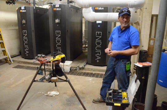 Mike Williams of Hunter-Prell Co. of Battle Creek is installing new boilers at the Battle Creek YMCA.