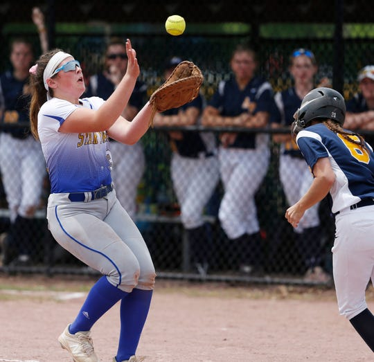 Maine-Endwell's Amanda DeSantis catches a fly ball during the 2018 NYSPHSAA Softball Championships.