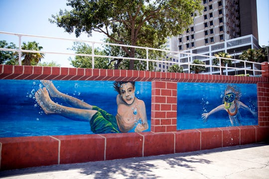 These murals of children swimming are located at the old bluff tunnel by La Retama Park in downtown Corpus Christi.