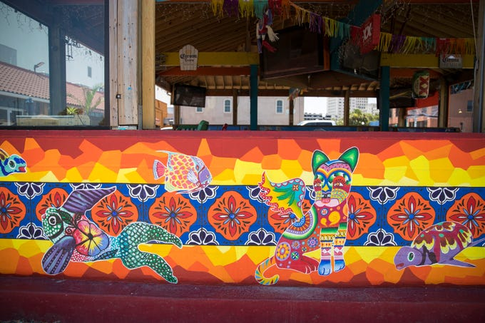 This mural is located outside the patio at La Playa By the Bay at 227 N. Water St.
