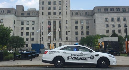 A Camden County police car sits outside Camden City Hall.