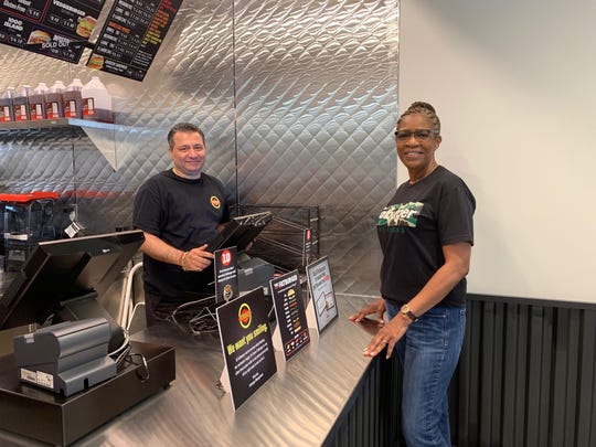 Praveen Vig, Cherry Hill franchise owner, and Mary McGill, director of operations, are on site for the opening of Fatburger in Cherry Hill.