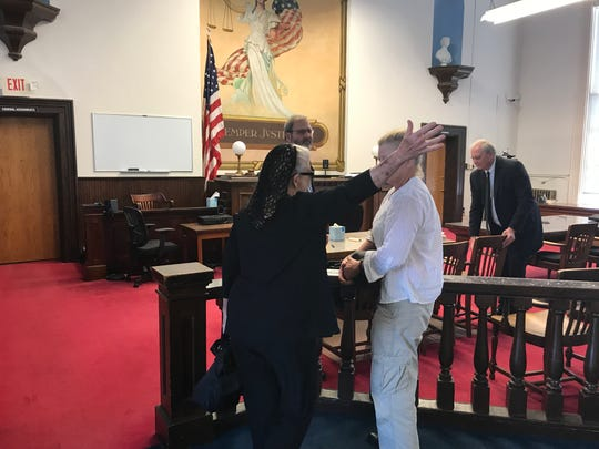 "Fredericka Wagner prepares to hug her daughter Robin after charges related to perjury in the case of the murders of the Rhoden family were dismissed by the prosecution Wednesday, June 26, 2019, in Pike County Common Pleas Court. Prosecutors report they intend to refile the charges but need to further analyze ""new and favorable"" evidence."