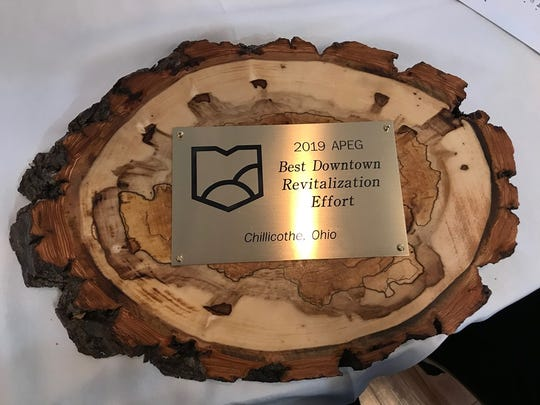 Chillicothe, Ohio was given the best downtown revitalization effort award by APEG. The award was made using locally sourced wood.