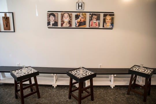Pictures of Pat and Jane Highland's grandchildren are a large part of the décor at Highland's Ice Creamery on Paint Street in downtown Chillicothe.