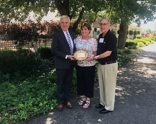 Adena CEO Jeff Graham, Downtown Chillicothe Director Tiffany Baldwin and Downtown Chillicothe board member Jim Doersam were honored with the best downtown revitalization efforts award for their work in Chillicothe, Ohio.