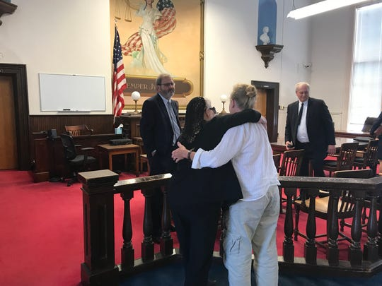 Fredericka Wagner embraces her daughter, Robin, in Pike County Court Wednesday after charges against her were dismissed.