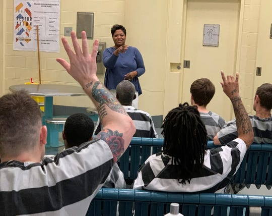 Trina Jackson, director of the Hamilton County Office of Re-entry, speaks to inmates about transitioning back into the community and connecting with the Office of Re-entry when they are released.