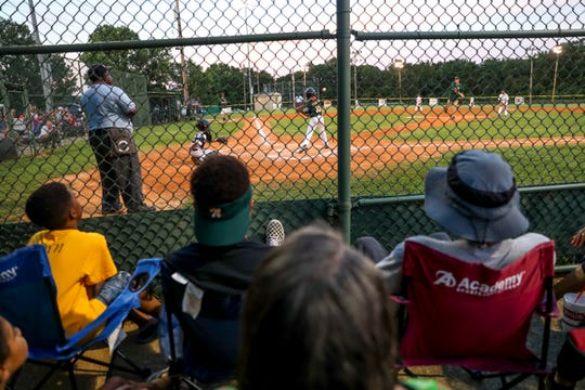 Fans watch as their players take turns at the bat at Stokes Ball Park in Clarksville, Tenn., on Tuesday, June 25, 2019.