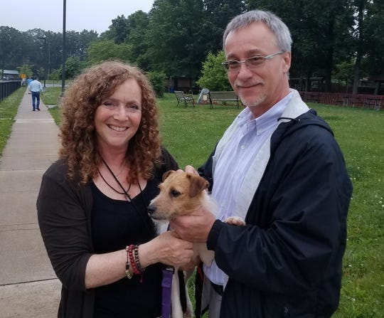 Cheryl and Stuart Brown with their newly adopted dog Riley.