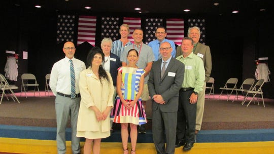 (First row, left to right) Dr. Ann DeRosa-principal, First Lady Tammy Murphy, and Dr. Jonathan Hart, superintendent. (Second row, left to right) John Albanese, deputy mayor;  Betty Ann Fort-Mayor, Carol Hample, BOE member; Jared Beatrice, BOE member' Don Race,-facilities manager; Ray Egbert, BOE member; and Eric Zwerling, BOE member.