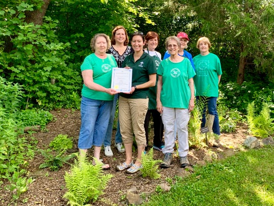 The Basking Ridge Garden Club members (leftto right) Barb Barbeau, Jan Blakeman, Helen Mehan, Lee Cleary, Rose Salaki, Margaret Cronin, and Environmental Education Center Manager Carrie Springer (center) display their recently bestowed runner's up award. Missing areKrista Colwell, Breda Ryan-Blake, and Tillie Emmert.